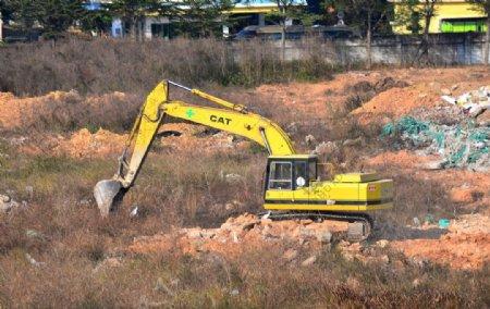 黄色挖掘机图片
